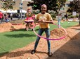 A girl hula-hoops at the pop-up park during Gresham's CityFest event.
